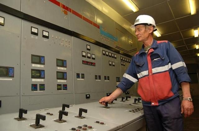 Машинист угольных и цементных мельниц на своем рабочем месте